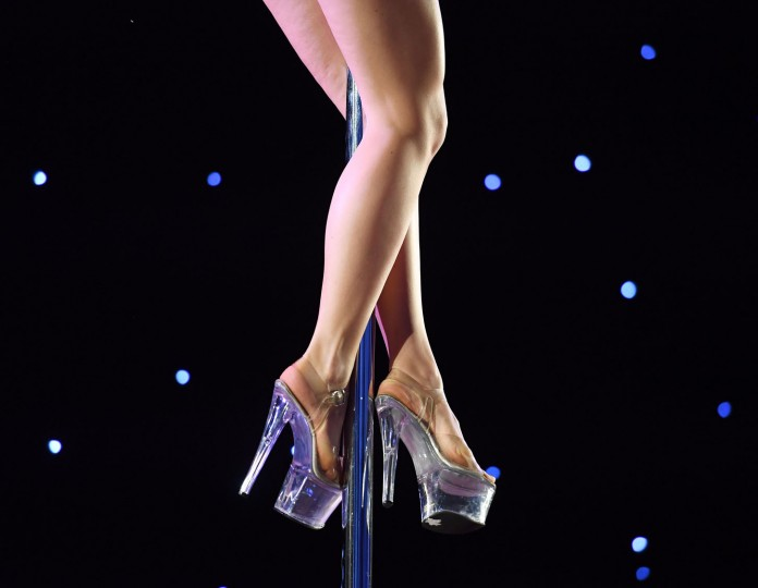 A competitor performs during the 2017 Pacific Pole Championships at the Convention Center in Los Angeles, California on April 8, 2017. Combining dance and acrobatics, originally began as entertainment in strip clubs, pole dancing soon became mainstream as a form of exercise and expression. Competitions are now held in countries throughout the world and has a participant level estimated at over 30,000 in the US. (Mark Ralston/AFP/Getty Images)