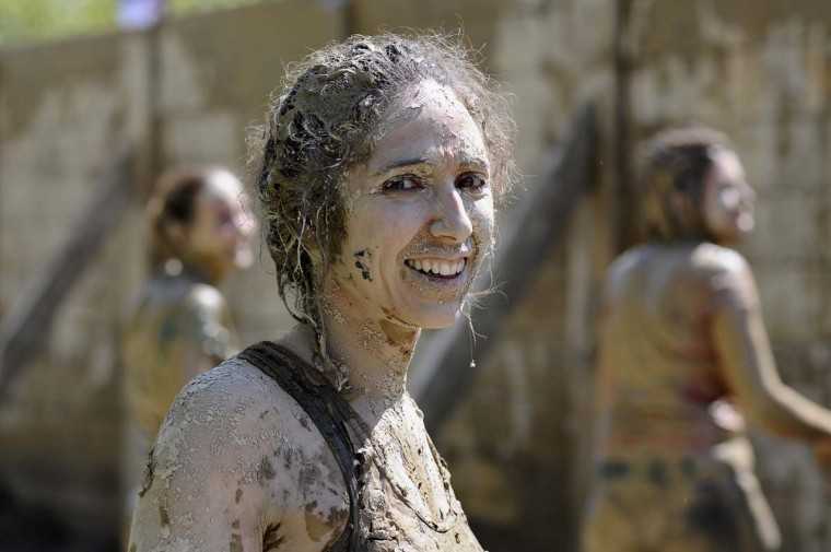 A participant smiles as she takes part in the Mud Day, a 13km race with obstacles, on April 8, 2016, at the Lac de Peyrolles, near Aix en Provence, southern France. (FRANCK PENNANT/AFP/Getty Images)
