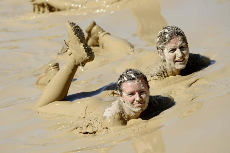 Runners take part in the Mud Day, a 13km race with obstacles, on April 8, 2016, at the Lac de Peyrolles, near Aix en Provence, southern France. (FRANCK PENNANT/AFP/Getty Images)