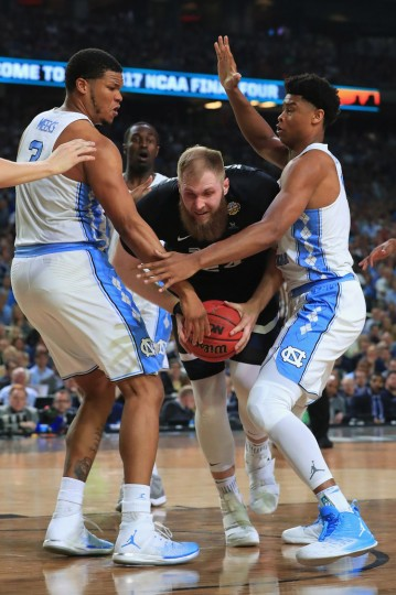 Przemek Karnowski #24 of the Gonzaga Bulldogs handles the ball against Kennedy Meeks #3 and Isaiah Hicks #4 of the North Carolina Tar Heels in the second half during the 2017 NCAA Men's Final Four National Championship game at University of Phoenix Stadium on April 3, 2017 in Glendale, Arizona. (Photo by Ronald Martinez/Getty Images)