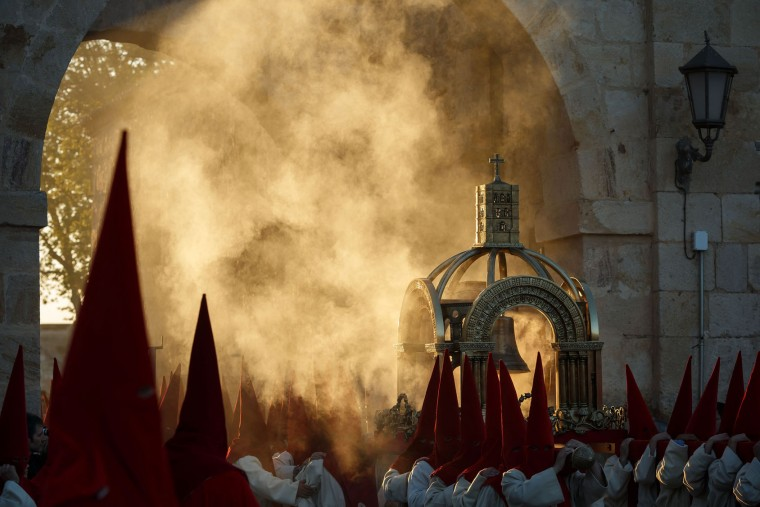 "Penitents from the ""Real Hermandad del Santisimo Cristo de las Injurias"" brotherhood prepare for a the ""El Silencio"" procession during Holy Week in the northwestern Spanish city of Zamora on April 12, 2017. Christian believers around the world mark the Holy Week of Easter in celebration of the crucifixion and resurrection of Jesus Christ. (Cesar Manso/AFP/Getty Images)"