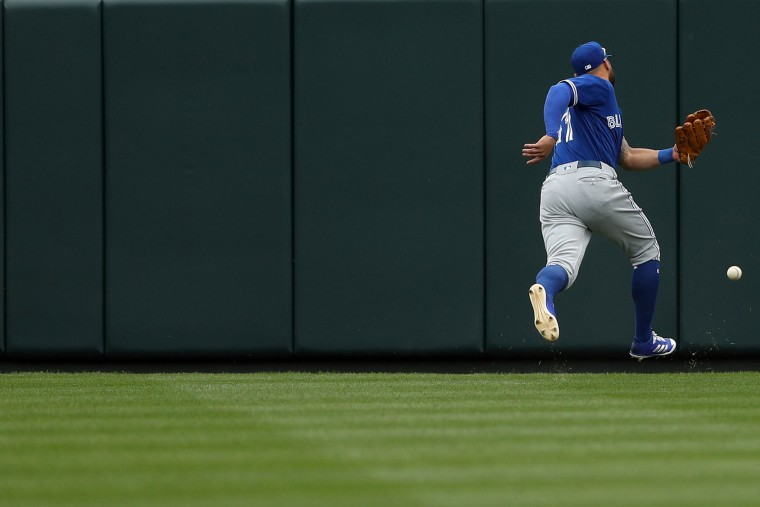 Kevin Pillar #11 of the Toronto Blue Jays cannot make a catch on a hit by Seth Smith #12 of the Baltimore Orioles (not pictured) during the third inning in their Opening Day game at Oriole Park at Camden Yards on April 3, 2017 in Baltimore, Maryland (Photo by Patrick Smith/Getty Images)