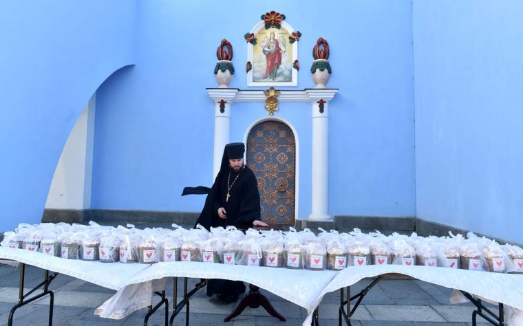 A priest looks at paskhas prepared to be sanctified and sent to Ukrainian servicemen fighting with pro-Russian separatists in the east of the country, during the blessing ceremony, in Kiev, on April 12, 2017. Ukrainian believers will celebrate the Easter, main holiday in Orthodox church, on April 16, 2017. (SERGEI SUPINSKY/AFP/Getty Images)