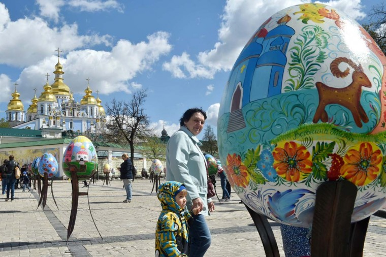 People examine huge Easter eggs as they walk in the open air festival in the center of Kiev on April 12, 2017. Some 500 traditional Ukrainian pysankas, painted Easter eggs, are presented in the center of Kiev before the celebration of the Easter, main holiday of the Orthodox church, on April 16. (SERGEI SUPINSKY/AFP/Getty Images)