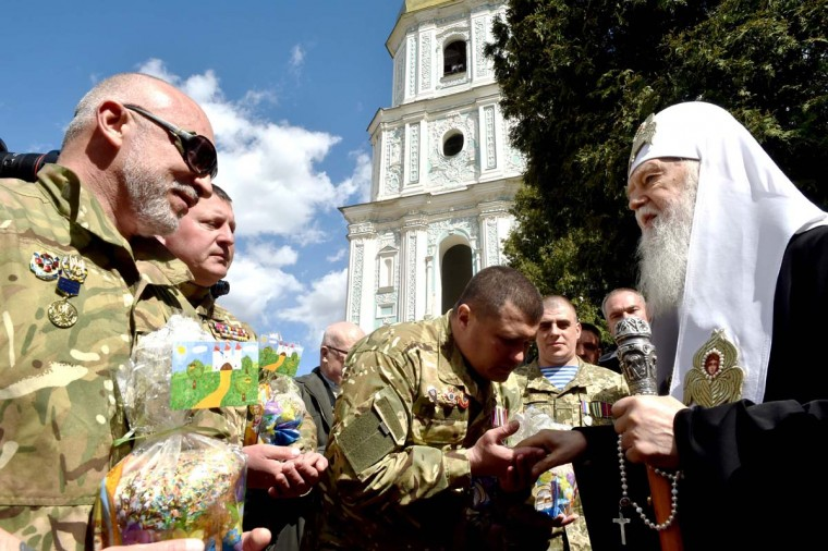 Patriarch of Ukrainian Orthodox Church (Kiev Patriarchy) Filaret blesses Ukrainian servicemen fighting against pro-Russian separatists in Eastern Ukraine, during a ceremony in Kiev on April 12, 2017. Ukrainian believers will celebrate the Easter, main holiday in Orthodox church, on April 16, 2017. (SERGEI SUPINSKY/AFP/Getty Images)