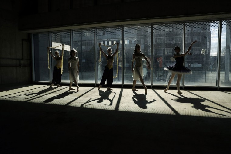 Dancers from the Central School of Ballet pose for photographers against a window during a photocall in the unfinished interior of their new building on Paris Garden in the Southwark area of London, Tuesday, March 21, 2017. The school are undertaking a 6 million pound fundraising campaign to finish the building developments and are going on a five-month, 23 date tour around Britain from March 30 onwards. (AP Photo/Matt Dunham)