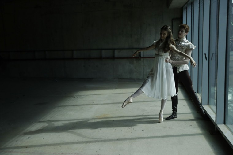 Amy McEntee, as Juliet, and Ruaridh Bisset, as Romeo, dancers from the Central School of Ballet hold a pose for photographers during a photocall in the unfinished interior of their new building on Paris Garden in the Southwark area of London, Tuesday, March 21, 2017. The school are undertaking a 6 million pound fundraising campaign to finish the building developments and are going on a five-month, 23 date tour around Britain from March 30 onwards. (AP Photo/Matt Dunham)