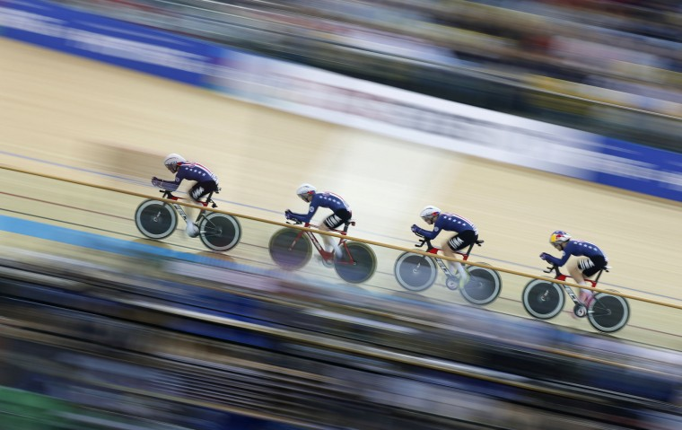 The United States compete in the women's team pursuit quarterfinal against Italy at the World Track Cycling championships in Hong Kong, Thursday, April 13, 2017. (AP Photo/Kin Cheung)