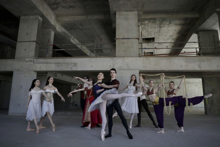 Dancers from the Central School of Ballet hold poses for photographers during a photocall in the unfinished interior of their new building on Paris Garden in the Southwark area of London, Tuesday, March 21, 2017. The school are undertaking a 6 million pound fundraising campaign to finish the building developments and are going on a five-month, 23 date tour around Britain from March 30 onwards. (AP Photo/Matt Dunham)