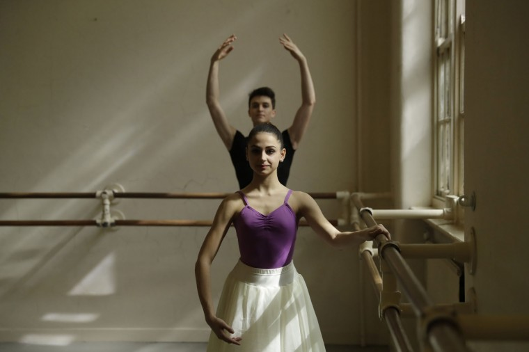 Italian students Rahien Testa, at back, aged 19 from Travedona-Monate, and Sara Delicati, aged 18 from Perugia, run through exercises as they pose for photographs in a studio at the Central School of Ballet in London, Tuesday, April 25, 2017. The full-time senior ballet school offers a three-year course for 16 to 19-year-olds from Britain and around the world, with students going on to have careers in classical ballet, contemporary dance and musical theatre. In the final year, students join the school's graduate touring company Ballet Central and work towards obtaining the BA (Hons) degree in Professional Dance and Performance. (AP Photo/Matt Dunham)
