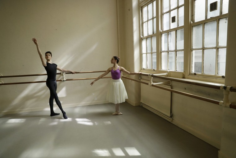 Italian students Rahien Testa, left, aged 19 from Travedona-Monate, and Sara Delicati, aged 18 from Perugia, pose for photographs in a studio at the Central School of Ballet in London, Tuesday, April 25, 2017. The full-time senior ballet school offers a three-year course for 16 to 19-year-olds from Britain and around the world, with students going on to have careers in classical ballet, contemporary dance and musical theatre. In the final year, students join the school's graduate touring company Ballet Central and work towards obtaining the BA (Hons) degree in Professional Dance and Performance. (AP Photo/Matt Dunham)