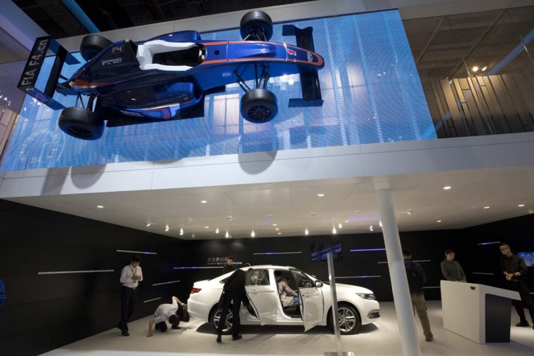 Visitors at the Geely stand during the Auto Shanghai 2017 show at the National Exhibition and Convention Center in Shanghai, China, Wednesday, April 19, 2017. Models on display at Auto Shanghai 2017, the global industry's biggest marketing event of the year, reflect the conflict between Beijing's ambitions to promote environmentally friendly propulsion and Chinese consumers' love of hulking, fuel-hungry SUVs. (AP Photo/Ng Han Guan)