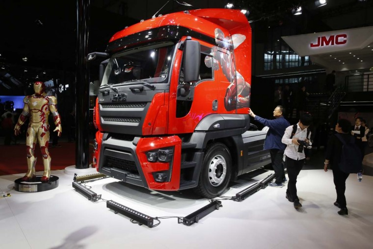 Workers clean a truck from Chinese automaker JMC during the Auto Shanghai 2017 show at the National Exhibition and Convention Center in Shanghai, China, Wednesday, April 19, 2017. Models on display at Auto Shanghai 2017, the global industry's biggest marketing event of the year, reflect the conflict between Beijing's ambitions to promote environmentally friendly propulsion and Chinese consumers' love of hulking, fuel-hungry SUVs. (AP Photo/Ng Han Guan)