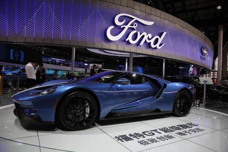 A sports car is displayed at the Ford stand during the Auto Shanghai 2017 show at the National Exhibition and Convention Center in Shanghai, China, Wednesday, April 19, 2017. Models on display at Auto Shanghai 2017, the global industry's biggest marketing event of the year, reflect the conflict between Beijing's ambitions to promote environmentally friendly propulsion and Chinese consumers' love of hulking, fuel-hungry SUVs. (AP Photo/Ng Han Guan)