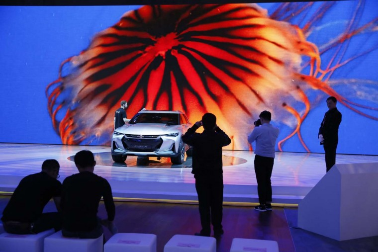 Visitors take photos of the Chevrolet FNR X concept car displayed at the Auto Shanghai 2017 show at the National Exhibition and Convention Center in Shanghai, China, Wednesday, April 19, 2017. Models on display at the Auto Shanghai 2017, the global industry's biggest marketing event of the year, reflect the conflict between Beijing's ambitions to promote environmentally friendly propulsion and Chinese consumers' love of hulking, fuel-hungry SUVs. (AP Photo/Ng Han Guan)