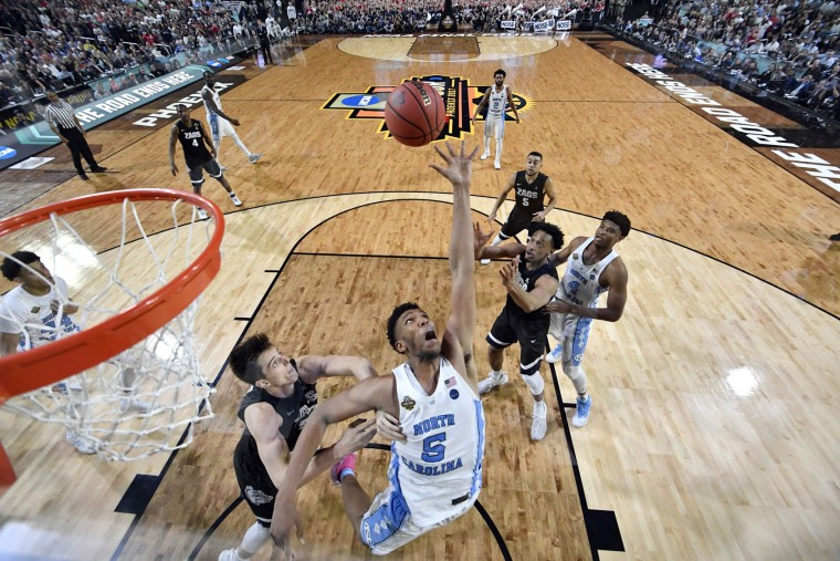 North Carolina's Tony Bradley (5) reaches for a rebound against Gonzaga's Zach Collins during the second half in the finals of the Final Four NCAA college basketball tournament, Monday, April 3, 2017, in Glendale, Ariz. (AP Photo/Chris Steppig, Pool)