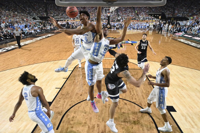 North Carolina's Isaiah Hicks (4) and North Carolina's Tony Bradley (5) reach for a rebound during the second half in the finals of the Final Four NCAA college basketball tournament against Gonzaga, Monday, April 3, 2017, in Glendale, Ariz. (AP Photo/Chris Steppig, Pool)