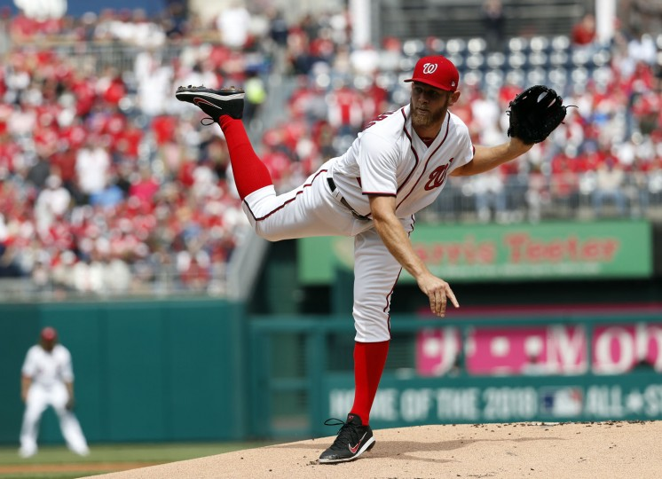 Washington Nationals starting pitcher Stephen Strasburg throws during an opening day baseball game against the Miami Marlins, at Nationals Park, Monday, April 3, 2017, in Washington. (AP Photo/Alex Brandon)