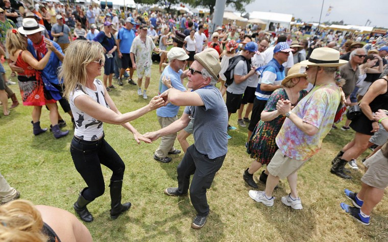 Jennie McColl and Bern Pagan, both from the D.C. area, dance during the New Orleans Jazz and Heritage Festival at the Fairgrounds, Friday, April 25, 2017. (Ted Jackson/NOLA.com The Times-Picayune via AP)