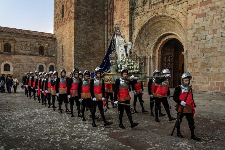 Penitents from the 'Armaos' brotherhood take part in a procession in Siguenza, Spain, on Tuesday, April 11, 2017. Hundreds of processions take place throughout Spain during the Easter Holy Week. (AP Photo/Daniel Ochoa de Olza)