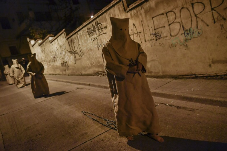 "'Ensacados' or masked penitents take part in the procession of the ""Silencio del Santisimo Cristo del Rebate"" brotherhood, during Holy Week in Tarazona, northern Spain, Tuesday, April 11, 2017. Hundreds of processions take place throughout Spain during the Easter Holy Week. (AP Photo/Alvaro Barrientos)"