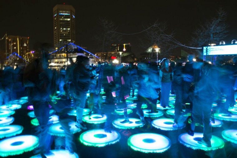 Visitors rush through The Pool [Reflect], a installation of interactive platforms at Light City Baltimore on Wednesday, April 5, 2017. (Emma Harris, Baltimore Sun)