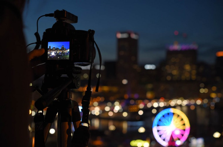 A photographer takes a picture from Federal Hill of the harbor during Light City Baltimore as it hosts a festival of lights, music and innovation March 31-April 8 2017. (Lloyd Fox, Baltimore Sun)