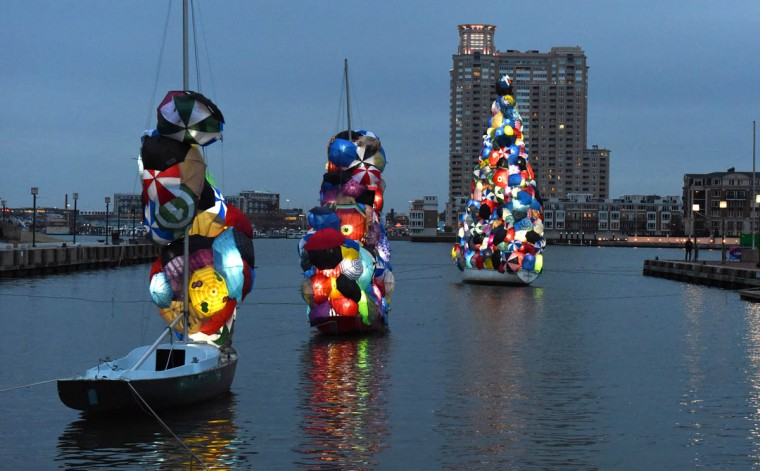 Drift by Stephanie Imbeau is a site-specific installation covering three sailboats with umbrellas illuminated from underneath. (Jerry Jackson/Baltimore Sun)