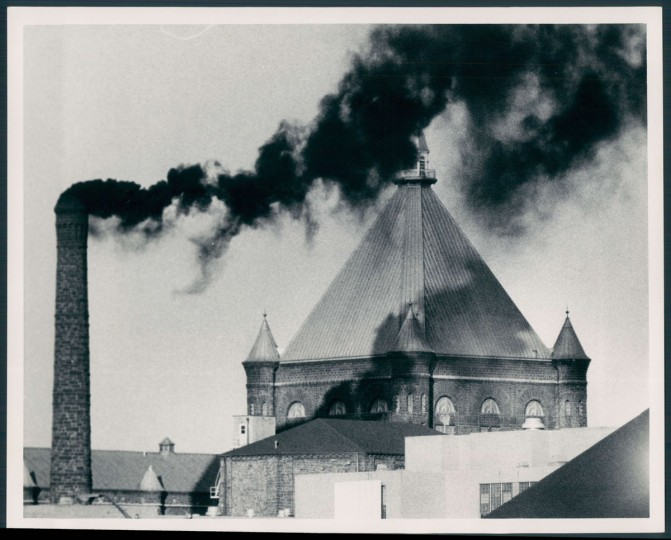 Smoke pumps out from the state penitentiary in downtown Baltimore. Photo dated December 7, 1972. (Baltimore Sun)