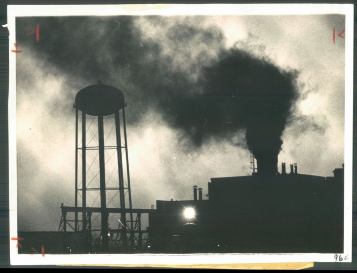 POLLUTER IN ACTION Smoke from the American Standard Corporation's plant at 5005 Holabird avenue blackens the East Baltimore skyline. The company, the third biggest pollution source in the region, is spending 1 million to install air pollution control equipment. Photo dated March 23, 1970. (Baltimore Sun)
