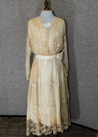 Long pink wedding dress with lace overlay and long sleeves. Gift of Miss Emily Rote. (Photo from the Baltimore Historical Society via Enoch Pratt Library)
