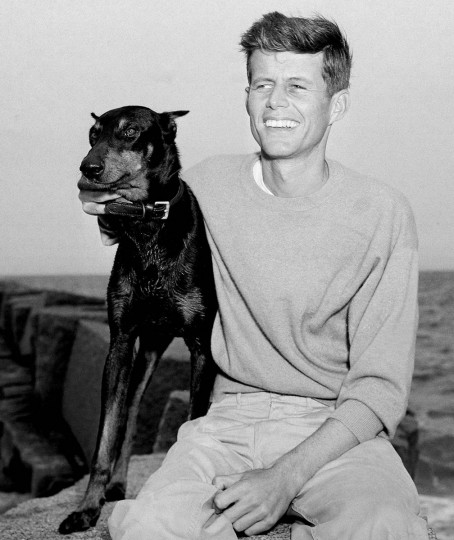 In this June 22, 1946 file photo, John F. Kennedy, winner of the Democratic Nomination for Congress in the 11th Massachusetts District, relaxes with his dog, Mo, in Hyannis Port, Mass. Monday, May 29, 2017 marks the 100-year anniversary of the birth of Kennedy, who went on to become the 35th President of the United States. (AP Photo/Peter J. Carroll, File)