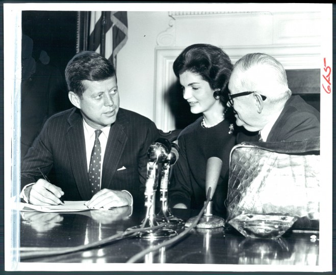 In this February 3, 1960 file photo, Senator John F. Kennedy (D., Mass) was joined by his wife Jackie and Governor J. Millard Tawes at the State House late yesterday as he signed papers making his entry into the Maryland Presidential primary a matter of record. (Ralph Robinson/Baltimore Sun)