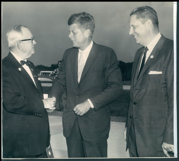 In this September 19, 1960 file photo, John F. Kennedy is greeted by Governor J. Millard Tawes and Louis Grasmick. (George Cook/Baltimore Sun)