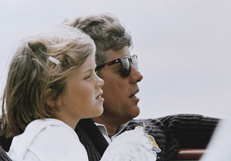 "In this 1962 file photo, President John F. Kennedy and his daughter, Caroline, sail off Hyannis Port, Mass. Caroline Kennedy said in a video released by the JFK Library on May 25, 2017, that she thought about her father and ""missed him every day of my life."" The 100th anniversary of JFK's birth is Monday, May 29, 2017. (AP Photo, File)"