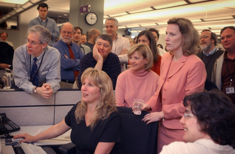 Baltimore Sun reporter Diana Sugg waits in the newsroom of The Baltimore Sun for the official announcement that she won a Pulitzer Award for beat reporting in 2003. (LLOYD FOX/Baltimore Sun)