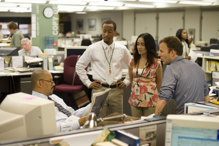"""In this photo released by HBO, (from left) actors Clark Johnson, Brandon Young, Michelle Paress, and Tom McCarthy in a scene from """"The Wire."""" For its fifth and final season, """"The Wire"""" ventured into a replica newsroom of The Sun, Baltimore's newspaper of record, where executive producer and lead writer David Simon worked for 13 years as a police reporter before he took a buyout in 1995. (AP Photo/Paul Schiraldi, HBO)"""