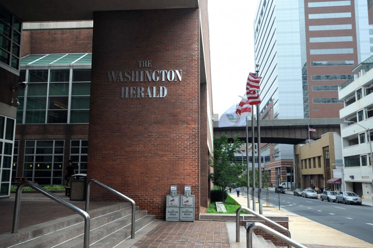 """Parts of the Baltimore Sun building are being used for filming of the Netflix show """"House Of Cards."""" This view shows the Sun building looking south on Calvert Street with """"The Washington Herald"""" on the column and on the newspaper boxes. (Baltimore Sun photo by Barbara Haddock Taylor)"""