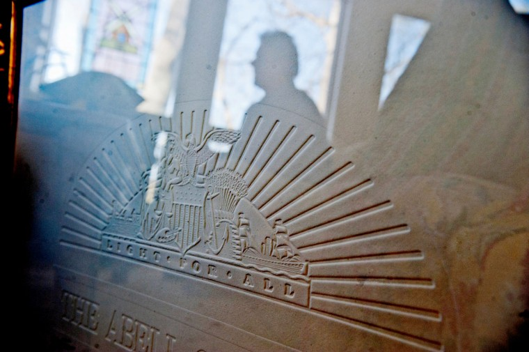 A first edition Sun embossed emblem, pictured in 2012. (Monica Lopossay/Baltimore Sun)