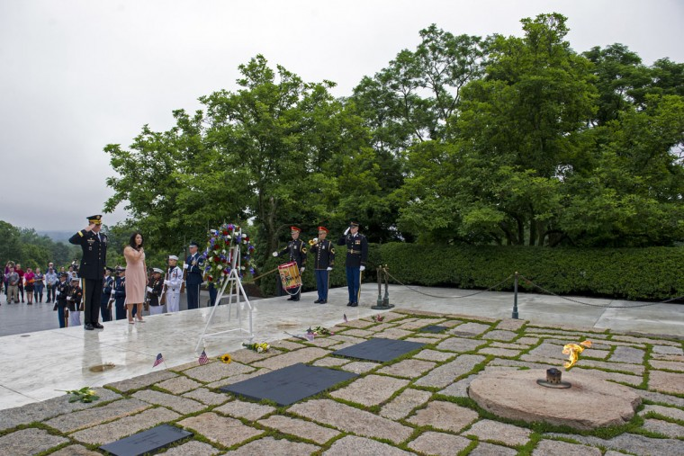 Army Major Gen. Michael Howard, commanding general of the Military District of Washignton, far left, and Karen Durham-Aquilera, executive director of Army National Cemeteries, lay a wreath at the grave of former President John F. Kennedy, to mark the 100th anniversary of his birth, at Arlington National Cemetery in Arlington, Va., Monday, May 29, 2017. Kennedy was born May 29, 1917. (AP Photo/Cliff Owen)