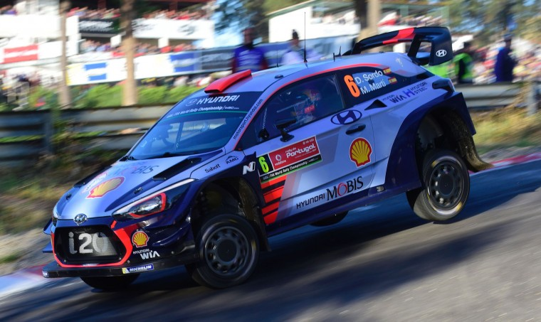 Spanish driver and co-driver Dani Sordo and Marc Marti, steer their Hyundai i20 Coupe WRC in Lousada, on May 18, 2017, during the Super Special opening stage of the Portuguese WRC rally. (Miguel Riopa/AFP/Getty Images)