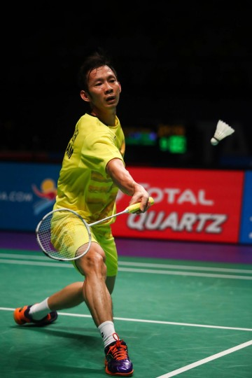 Vietnam's Nguyen Tien Minh hits a return during the men's singles Sudirman Cup match against Ryan Ng Zin Rei Ryan of Singapore at the Gold Coast Sports Centre on May 26, 2017. (Patrick Hamilton/AFP/Getty Images)