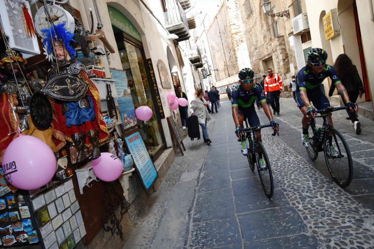 Colombia's Nairo Quintana (L) of team Movistar rides to the start of the 4th stage of the 100th Giro d'Italia, Tour of Italy, cycling race from Cefalu to Etna volcano, on May 9, 2017 in Sicily. (Luk Benies/AFP/Getty Images)