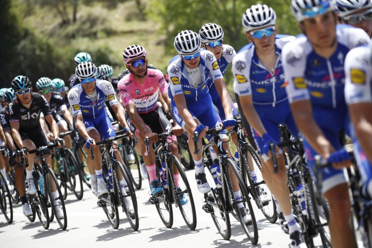 Pink jersey Colombia's Fernando Gaviria of team Quick-Step rides in the peloton during the 4th stage of the 100th Giro d'Italia, Tour of Italy, cycling race from Cefalu to Etna volcano, on May 9, 2017 in Sicily. (Luk Benies/AFP/Getty Images)