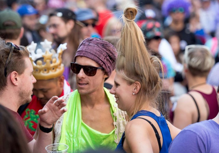 People in costume talk and dance during the 18th annual How Weird Street Faire in San Francisco, California on May 07, 2017. Several city blocks filled with thousands of people as they partied and danced in costume to electronic music and interacted with street performers and artists. (JOSH EDELSON/AFP/Getty Images)