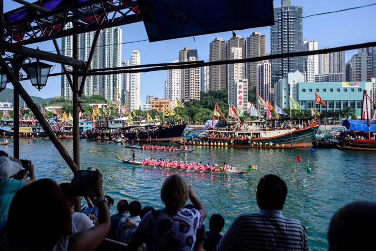 Spectators watch the annual dragon boat race held to celebrate the Tuen Ng festival in Hong Kong on May 30, 2017. (Anthony Wallace/AFP/Getty Images)