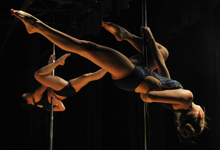 """Participants perform during the """"Kyrgyzstan Pole Sport Championship 2017"""" competition in Bishkek late on May 1, 2017. (VYACHESLAV OSELEDKO/AFP/Getty Images)"""