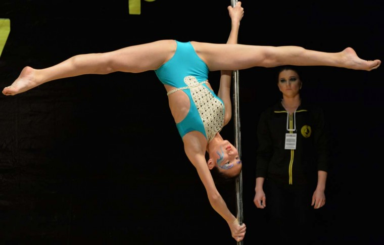 """A participant performs during the """"Kyrgyzstan Pole Sport Championship 2017"""" competition in Bishkek late on May 1, 2017. (VYACHESLAV OSELEDKO/AFP/Getty Images)"""
