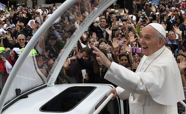 Pope Francis waves to faithful as he bids farewell after his visit to Fatima shrine, in Portugal. (FRANCISCO LEONG/AFP/Getty Images)