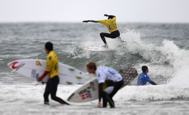Senegal's Thierno Sambe (C) competes in the heats 26 - Round 1 on May 23, 2017 in Biarritz, southwestern France, during the 2017 ISA World Surfing Games. (Franck Fife/AFP/Getty Images)